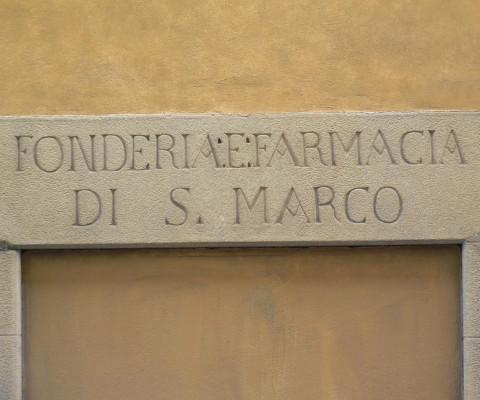 An earlier sign, alongside the entrance.