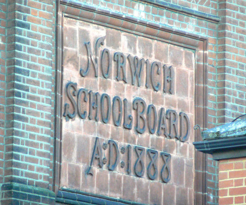 Plaque on the side of Norwich University of the Arts, Suke Street.