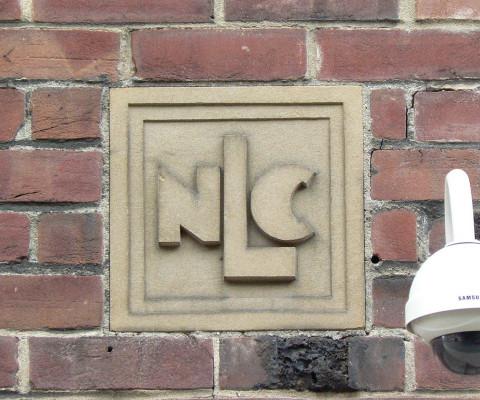 Lovely art deco raised lettering, off Elm Hill.