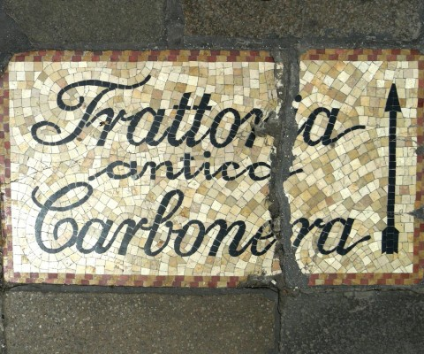 Pavement mosaic sign near Rialto